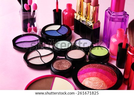 Set of decorative cosmetics on light colorful background - stock photo
