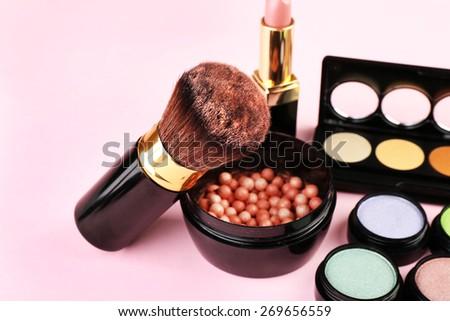 Set of decorative cosmetics on light colorful background - stock photo