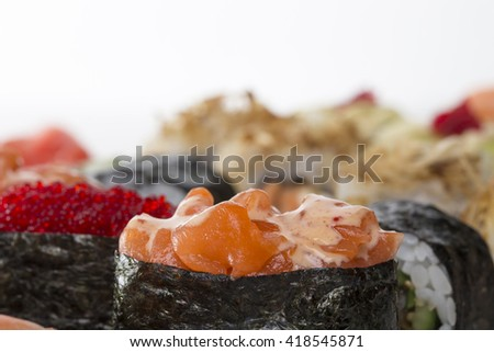 Set of delicious gunkans sushi. Gunkans with salmon and red robiko caviar. Macro. Photo can be used as a whole background. - stock photo