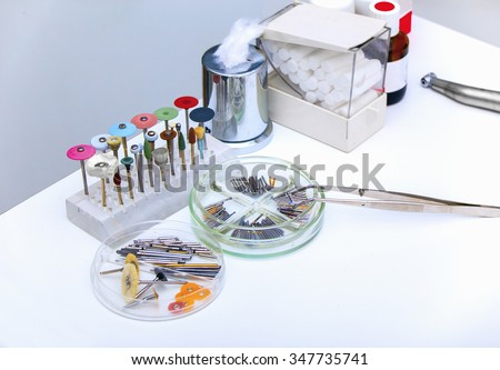 Set of dental burs and grinding wheels  on a white background - stock photo