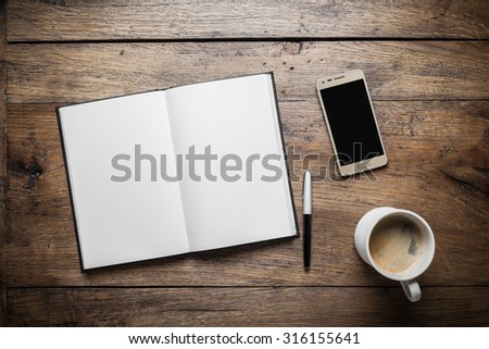 Set of diary, smartphone and coffee on wood background