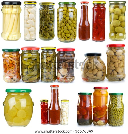 Set of different berries, mushrooms and vegetables conserved in glass jars isolated on the white background - stock photo