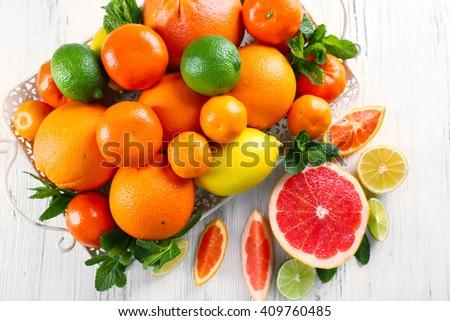 Set of different citrus fruit - stock photo