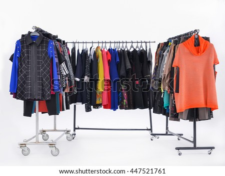 Set of different clothes for females on hanging - stock photo