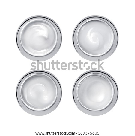 Set of 4 different cosmetics cream isolated on white  - stock photo