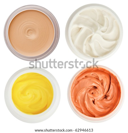 Set of 4 different dermal creams and gels isolated on white - stock photo