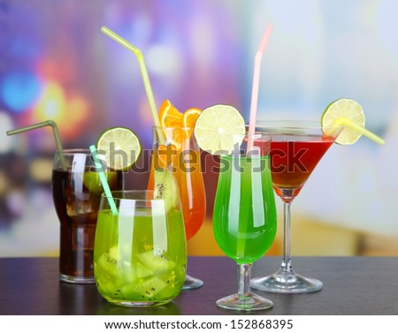 Set of different drinks on bright background - stock photo