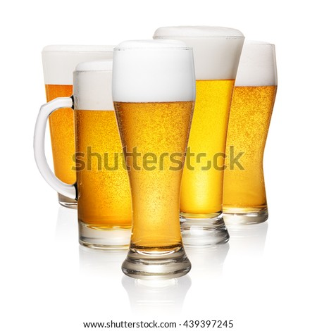 Set of different fresh beer glasses isolated on white background
