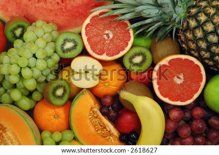 Set of different fresh fruits. Colorful background. - stock photo
