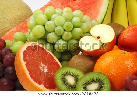 Set of different fresh fruits isolated on white - stock photo