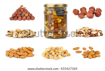 Set of different nuts isolated on white background - stock photo