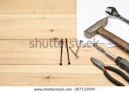 Set of different tools for repair and construction: hammer,screwdriver,screws,meter,wrench,hand tool - stock photo