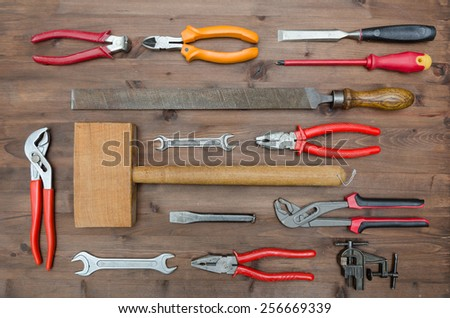 set of Different tools on a wooden background - stock photo