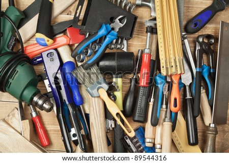 Set of different tools on a wooden planks - stock photo