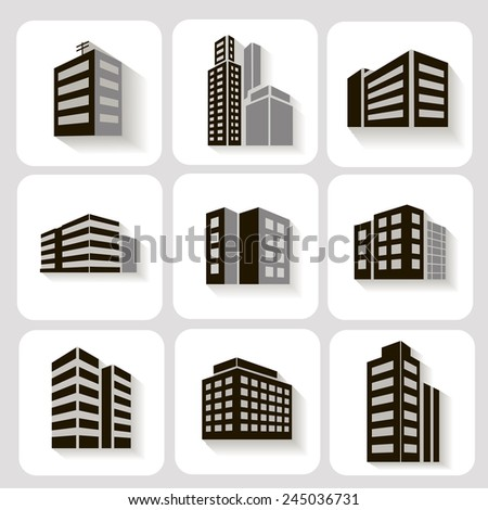 Set of dimensional buildings icons in grey and white with shadow depicting high-rise commercial buildings  office blocks and residential apartments - stock photo