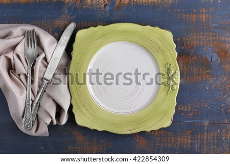 Set of dinnerware on wooden table - stock photo