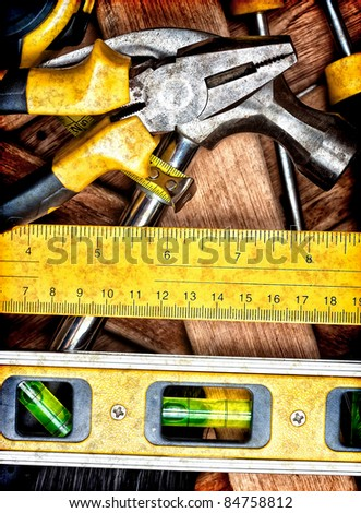Set of dirty and rusty manual tools on wooden boards - stock photo