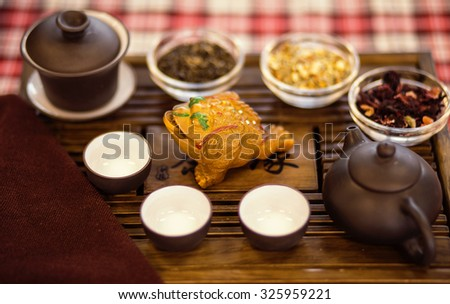 Set of dishes for chinese tea ceremony on tray