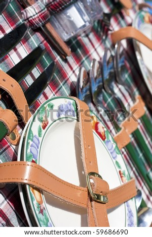 Set of dishware in the picnic basket - stock photo