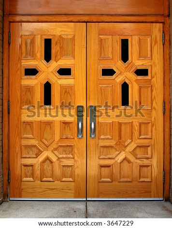 Set of double wooden church doors with cross patterns - stock photo