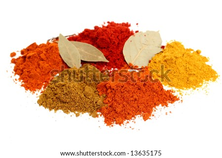 Set of dry spices with a bay leaf