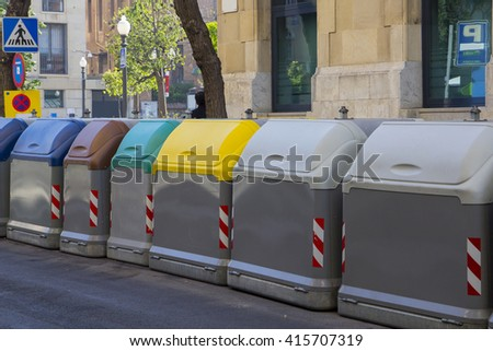 Set of dumpsters for rubbish recycling, in the street - stock photo