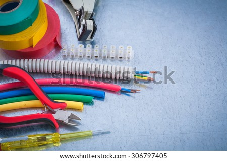 Set of electricianâ??s tools on scratched metallic surface construction concept. - stock photo