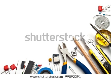 Set of electronic tools and components on white background - stock photo