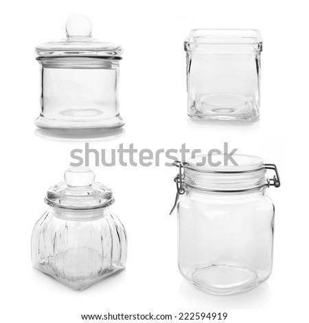 Set of empty glass jars isolated on white background. - stock photo