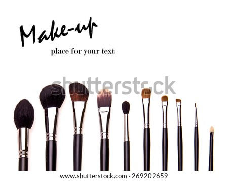 Set of essential professional make-up brushes are isolated with shadows on white background. Overhead view. Black and white kit. - stock photo