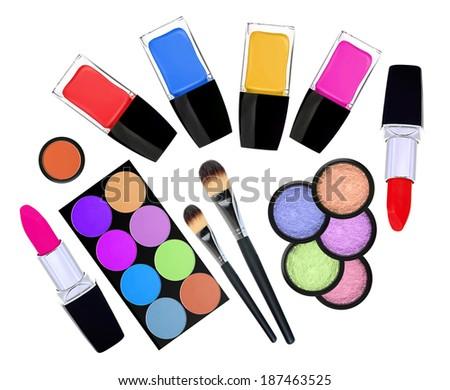 set of 5 eyeshadows, brushes, lipsticks and nailpolishes isolated on white - stock photo