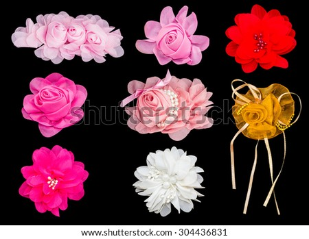 Set of fabric flower isolated on a black background - stock photo