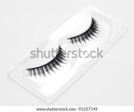 Set of fake eyelashes in white background. - stock photo