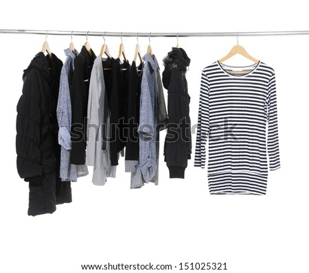 set of female clothes hanging on clothes rack