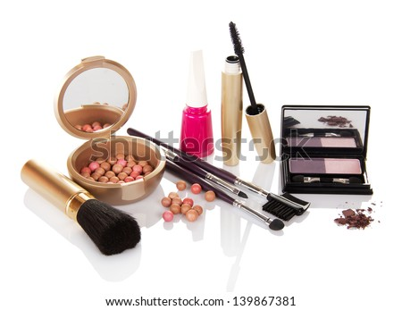 Set of female cosmetics and the nail varnish, isolated on white - stock photo