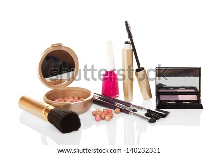 Set of female cosmetics and the nail varnish, isolated on white