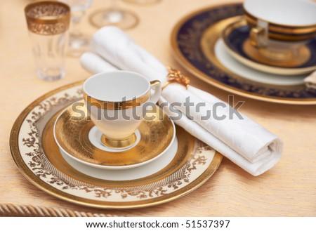 Set of fine bone porcelain dishware - stock photo