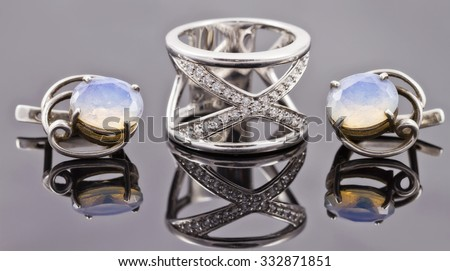set of fine silver jewelry : big ring and earrings with moonstone - stock photo