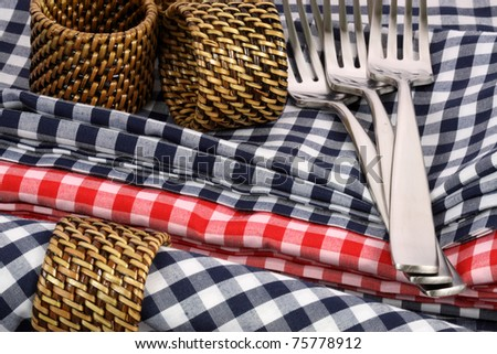 set of fine silverware on colorful table - stock photo