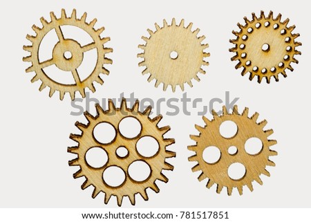 set of five different wooden cog wheels isolated on white background