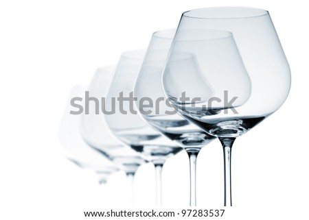 Set of five empty wine glasses on white background - stock photo