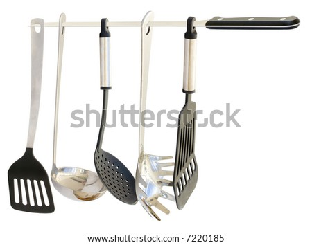 Set of five high quality kitchen utensils hanging from a Cured Ham knife. Isolated on white. - stock photo