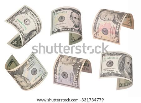 Set of flying dollar bills. Isolated on white - stock photo