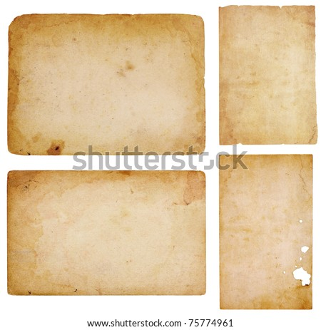 Set of four aged, worn and stained paper scraps isolated on white with room for text or images. - stock photo