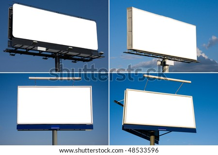 Set of four blank billboards on blue sky