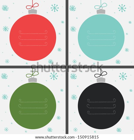 Set of four Christmas baubles in different colors with snowflakes and place for your text.