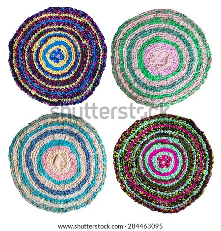 Set of four colorful hand made knitted rugs. Reuse of colorful flap. Folk nation creativity. Rustic style. Rough texture and bright design - stock photo