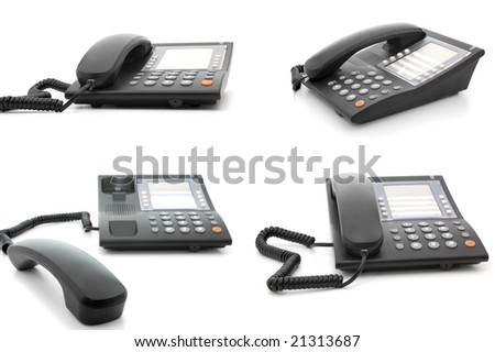 Set of four equal office corded telephones on different angles - stock photo