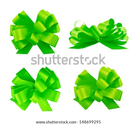 Set of four green gift ribbon bows isolated over white background, set of four foreshortenings