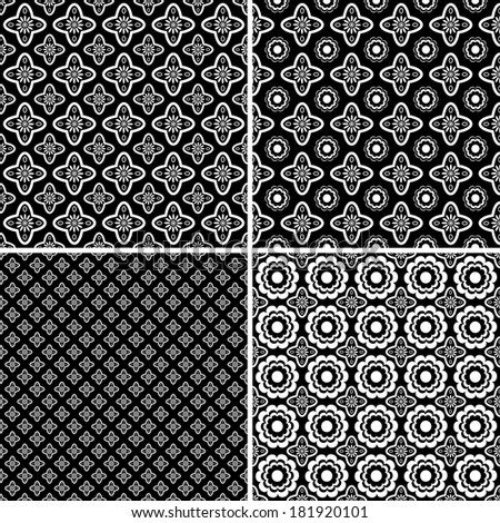 Set of four seamless black and white patterns.Raster.